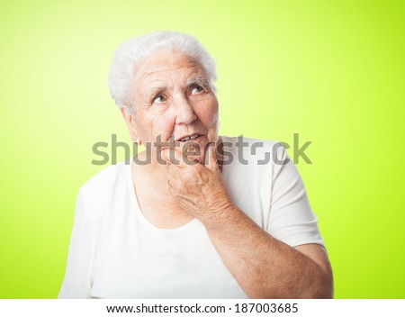 portrait of elder woman thinking about something - stock photo