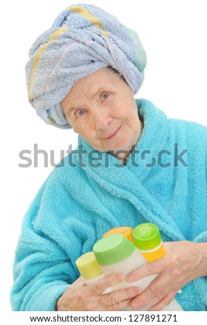 Portrait of elderly and beautiful woman in bathrobe isolated on white - stock photo