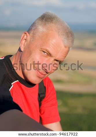 portrait of elderly gray-haired man - stock photo