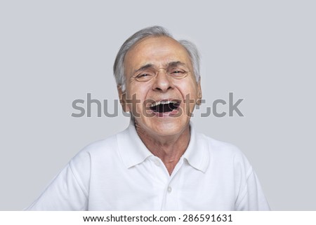 Portrait of elderly man laughing - stock photo
