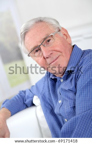 Portrait of elderly man with eyeglasses - stock photo
