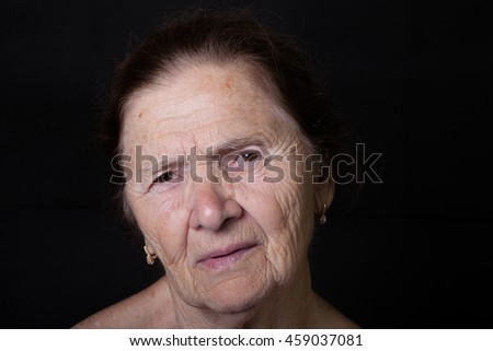 Portrait of elderly woman. Attentiveness.