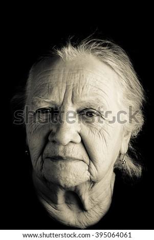 Portrait of elderly woman. Closeup view. Toned. - stock photo