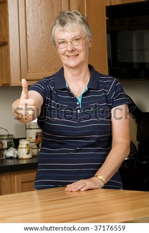 Portrait of elderly woman giving thumbs up