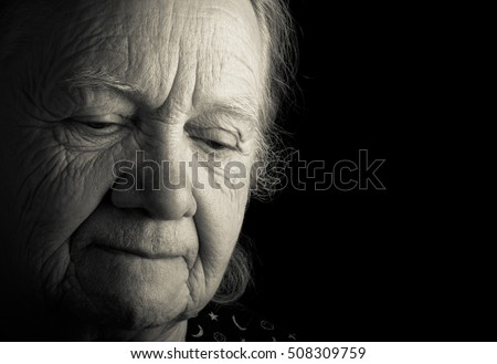 Portrait of elderly woman. Sad. Toned.