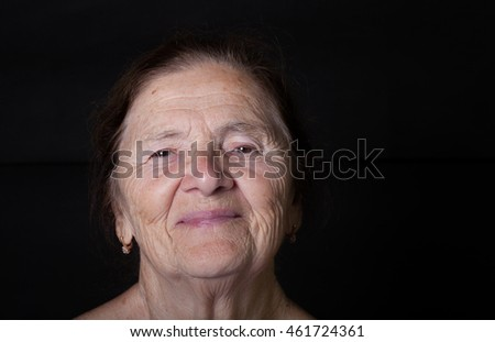 Portrait of elderly woman. Smile.