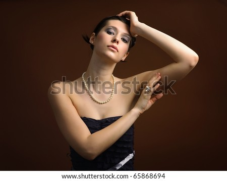 Portrait of elegance young woman wearing pearls necklace - stock photo