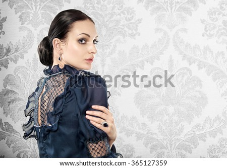 Portrait of elegant beautiful woman on light background. Space for text. - stock photo