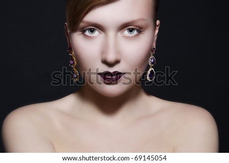Portrait of elegant beautiful woman wearing jewelry. - stock photo