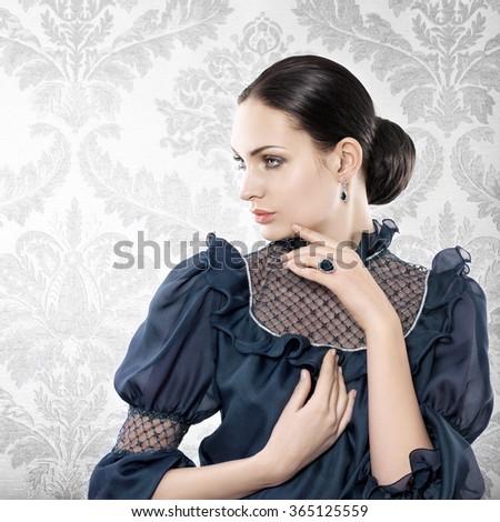 Portrait of elegant beautiful woman with jewellery - stock photo