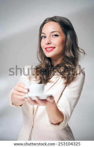 Portrait of elegant brunette beauty with cup of coffee. - stock photo
