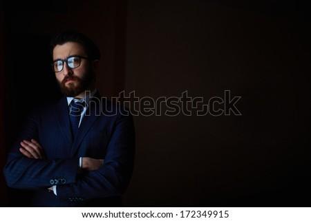 Portrait of elegant businessman in suit and eyeglasses - stock photo