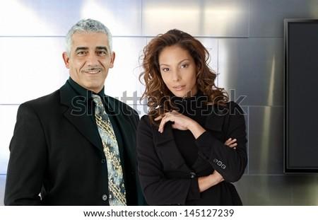Portrait of elegant businesspeople. Boss and secretary. - stock photo