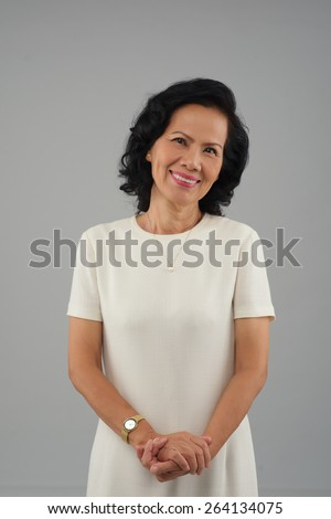 Portrait of elegant mature Vietnamese woman - stock photo
