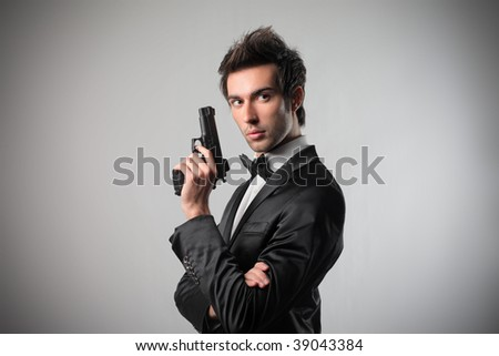 portrait of elegant spy with gun - stock photo