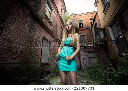 Portrait of elegant woman against ruined building - stock photo