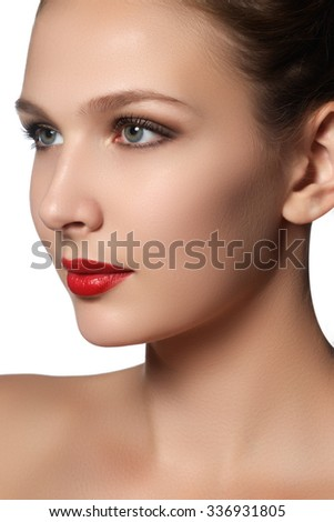 Portrait of elegant woman with red lips. Beautiful young model with red lips. Sexy woman model with bright red lips makeup, and healthy shiny skin. Evening glamour style, fashion make-up