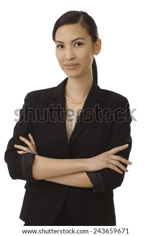 Portrait of elegant young Asian businesswoman standing arms crossed wearing black. - stock photo