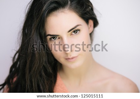 Portrait of elegant young brunette isolated on white - stock photo
