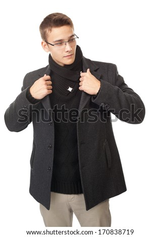Portrait of elegant young man holding his coat's collar isolated on white background