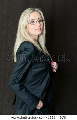 Portrait of elegantly dressed young gorgeous blond business woman. - stock photo