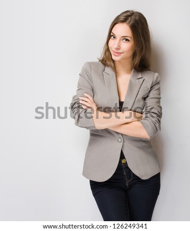 Portrait of elegantly dressed young gorgeous brunette woman. - stock photo