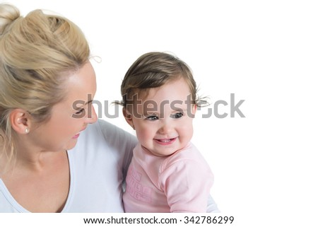 Portrait of embracing mom and baby little girl.Copy space. shallow doff, isolated on white - stock photo