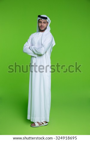 Portrait of Emirati businessman with arms crossed - stock photo
