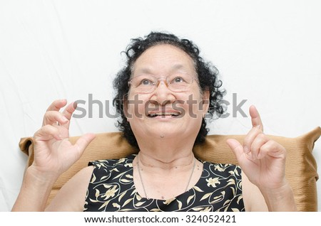Portrait of emotion asian senior woman with surprised expression