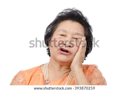 Portrait of emotion Asian senior woman with toothache isolated on white background, with clipping path - stock photo