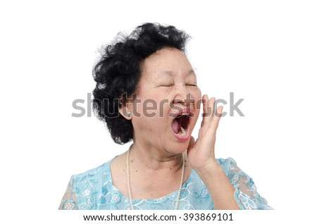 Portrait of emotion Asian senior woman with yawn expression isolated on white background, with clipping path - stock photo