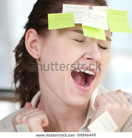 Portrait of emotional business woman with note papers - stock photo