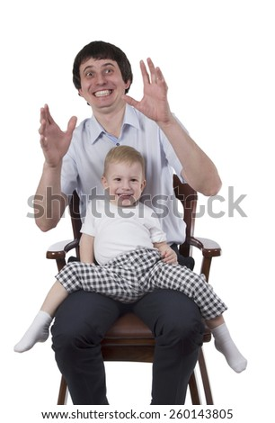 Portrait of emotional man holding child sitting on a chair isolated on white background - stock photo