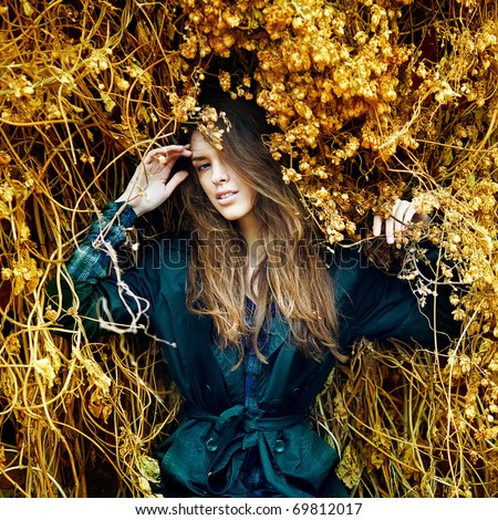 Portrait of emotional romantic woman standing on the autumn background - stock photo