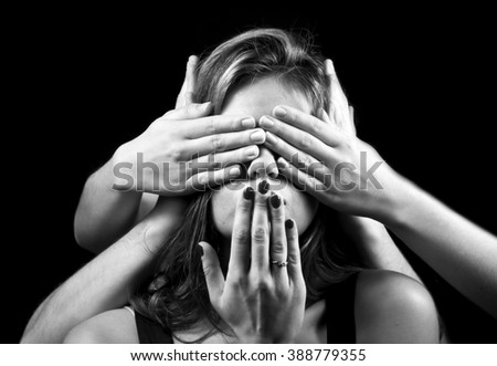 portrait of emotional young woman and lot of hands - stock photo