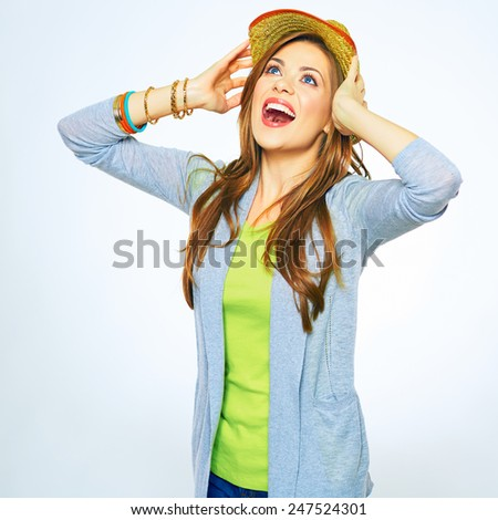 Portrait of emotional young woman looking up. White background isolated. - stock photo