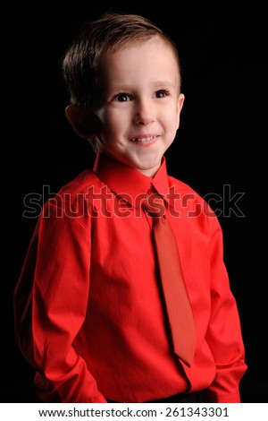 Portrait of emotionally kid. Emotional boy on the black background