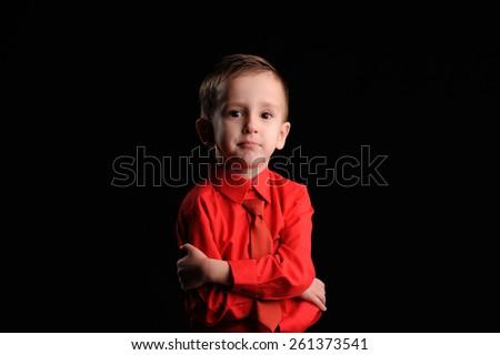 Portrait of emotionally kid. Emotional boy on the black background - stock photo