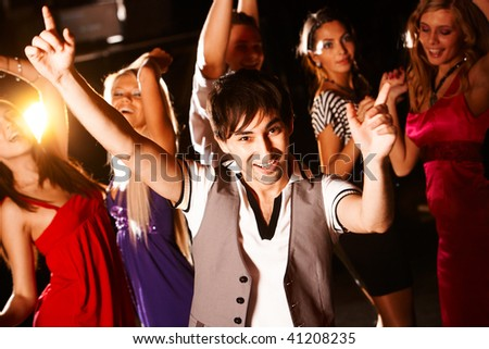 Portrait of energetic dancer on background of happy girls having fun