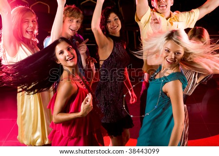 Portrait of energetic people clubbing at discotheque - stock photo