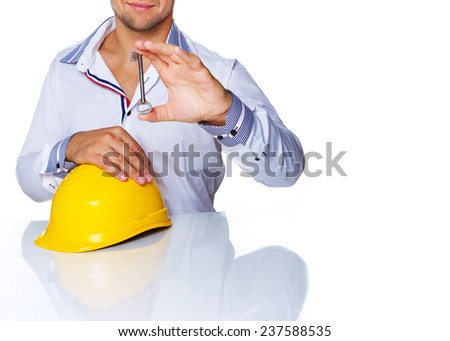 Portrait of engineer posing in studio with key from house - stock photo