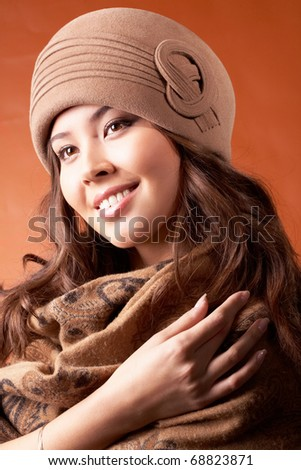 Portrait of enjoying woman in autumn clothes - stock photo