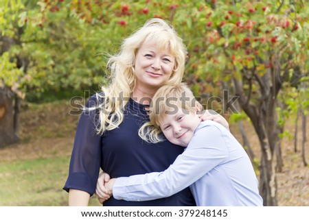 Portrait of European beautiful woman with son