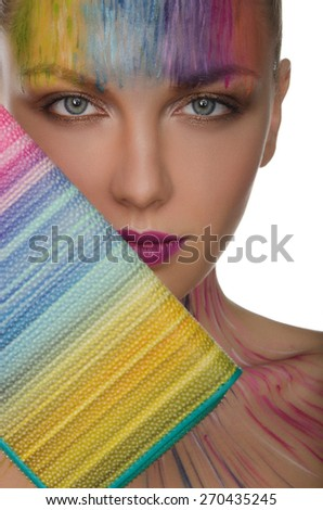 Portrait of european women with colorful purse and face art isolated on white - stock photo