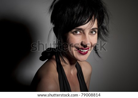 Portrait of evil looking gorgeous laughing woman - stock photo