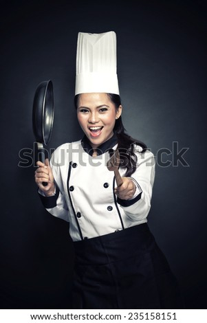 portrait of excited female chef or baker ready to cook - stock photo