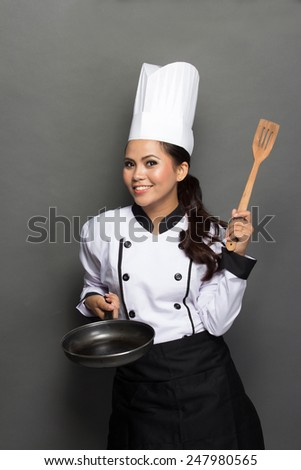 portrait of excited female chef ready to cook - stock photo