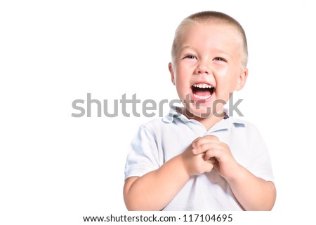 portrait of excited little boy laughing isolated over white - stock photo
