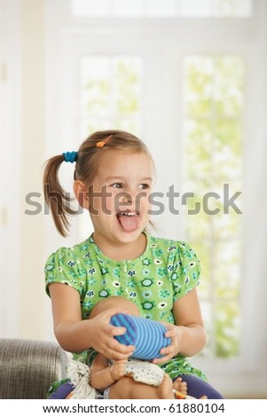 Portrait of excited little girl (3-4 years) playing at home.? - stock photo