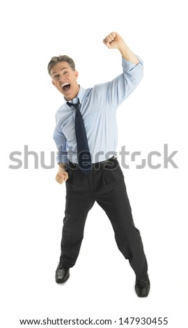 Portrait of excited mature businessman shouting while standing against white background